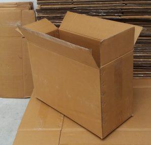 Caja de carton triple con grapas
